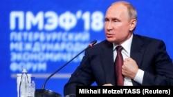 Russian President Vladimir Putin speaks at the St. Petersburg International Economic Forum in 2018.