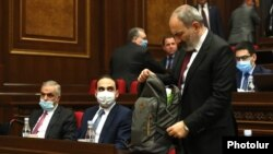 Prime Minister Nikol Pashinian and members of his government attend a parliament session in Yerevan on May 6.