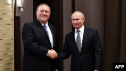 Russian President Vladimir Putin (left) meets with U.S. Secretary of State Mike Pompeo in Sochi on May 14.
