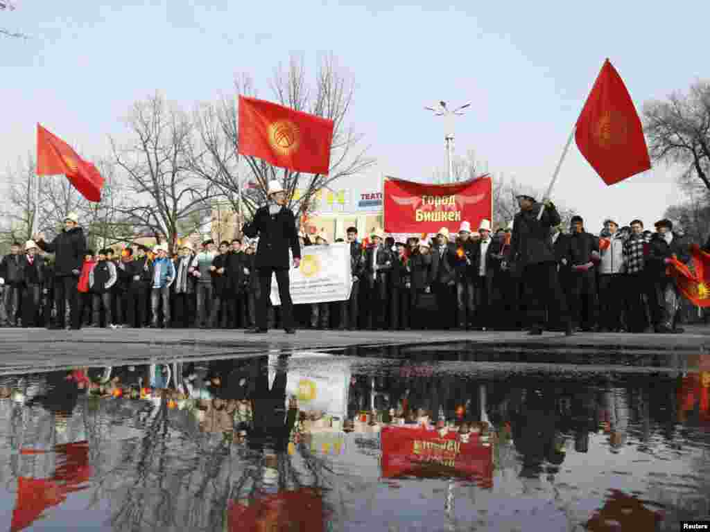 Kyrgyz youths wave national flags in a procession to commemorate State Flag Day in central Bishkek on March 3. Photo by Vladimir Pirogov for Reuters