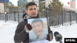 """Baibolat Kunbolatuly protests in front of the Chinese Embassy in Nur-Sultan in February 2020. """"I think about what would happen to my children if I were to die [in prison],"""" he says."""