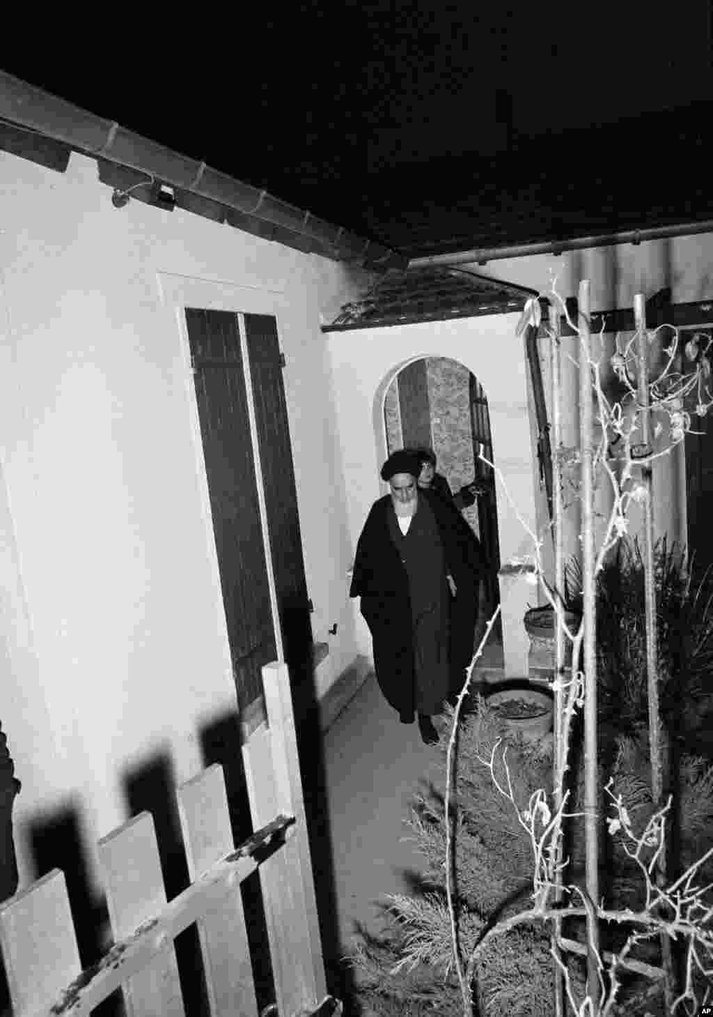 Khomeini leaves his residence in suburban Neauphle-le-Chateau for an evening prayer, just hours before leaving for Charles de Gaulle Airport in Paris on January 31, 1979.