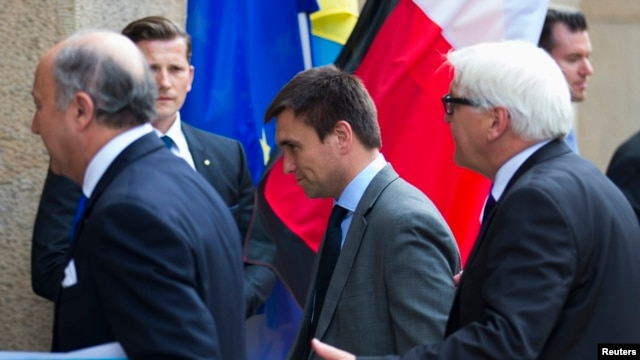 France's Foreign Minister Laurent Fabius (left), Ukraine's Foreign Minister Pavlo Klimkin, and Germany's Foreign Minister Frank-Walter Steinmeier arrive for a meeting to discuss the Ukrainian crisis in Berlin on July 2, 2014.