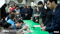 Voter in Iran's parliamentary elections on Friday wearing a mask for protection against coronavirus infection. February 21, 2020