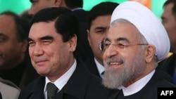 Türkmen prezidenti G.Berdimuhamedow eýranly kärdeşi Hassan Rohani bilen Ak ýaýla dermir ýol satansiýasynda, 3-nji dekabr, 2014 ý.