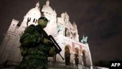 A French soldier stands guard outside the Sacre Coeur Basilica on November 16 in Paris.