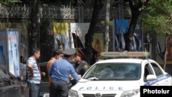 Armenia -- Traffic police fine a driver in Yerevan, undated.