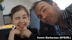 Yoann Barbereau and his daughter Eloise, in a photo taken during their first meeting upon his return to France after escaping Russian custody