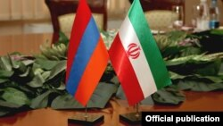 Armenia - Armenian and Iranian flags put on a table during bilateral talks in Yerevan, 29Aug2014.