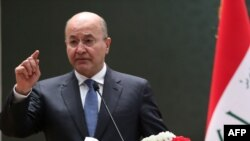 File photo - Iraqi President Barham Saleh has tried to maintain a delicate balance between its ally the United States and its neighbor, Iran.