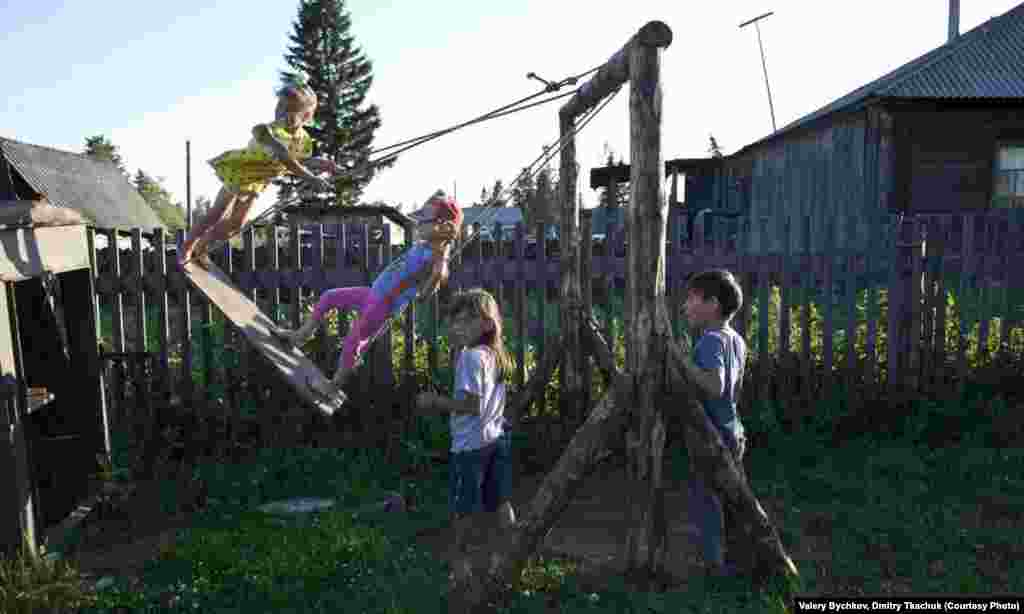 Children enjoy their backyard playground.