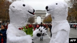 Activists dressed as polar bears take part in an environmentalist demonstration, which was held on the sidelines of a major climate change conference in Paris on December 12.