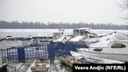 Some of the boats damaged by ice lie in the Belgrade stretch of the Danube River on February 20.