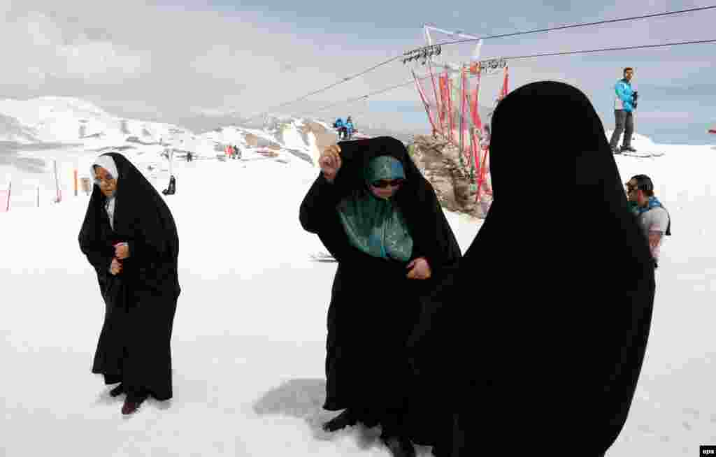Iranian women wearing Islamic dress attend a snowboard competition at the Tochal ski resort near Tehran on May 3. (epa/Abedin Taherkenareh)