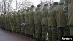 Some 200 Ukrainian veterans turned their backs to President Viktor Yanukovych.