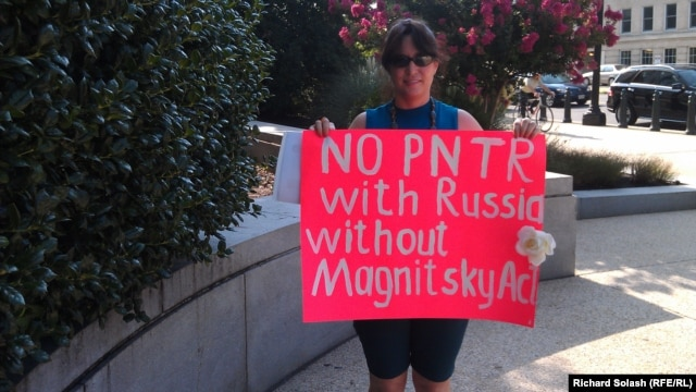 Russian-American Tanja Nyberg demonstrates outside of the Senate Finance Committee meeting on July 18.