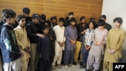 Police produce young children suspected of planting bombs to the media in Quetta on March 13.