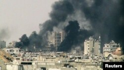 Syria - Smoke rises from Juret al-Shayah in Homs, 22Jul2012