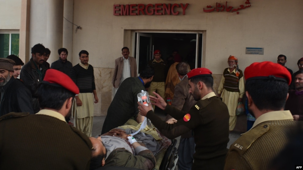 Pakistani soldiers shift an injured victim from a passenger bus hit in cross-border shelling, at a military hospital in Muzaffarabad, the capital of Pakistan-administered Kashmir, on November 23.