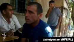 Azerbaijan - A screenshot of an amateur video of Armenian citizen Karen Petrosian talking to residents of Aqbulaq village.
