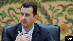 Syrian President Bashar Assad vows to fight terrorists and rules out foreign resolution to country's 16-month-old crisis.