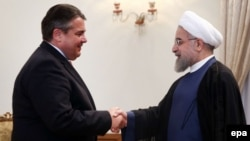 Iranian President Hassan Rohani (right) meets with German Economy Minister Sigmar Gabriel at the presidential office in Tehran on July 20.