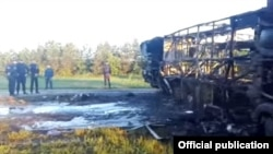 Photos from the scene showed a burned-out bus on its side and an overturned Kamaz truck.