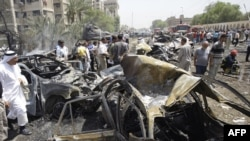 The scene of a massive explosion outside the Foreign Ministry in a residential area of central Baghdad.
