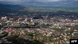 The Azerbaijani side has warned it could shell the capital of Karabakh, Stepanakert, if alleged attacks on Azerbaijani settlements are not halted, but it batted away Armenian-backed separatists' suggestion that it had targeted civilians.
