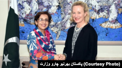 FILE: Alice Wells shaking hands with senior Pakistani diplomate Tahmina Janjua in January.