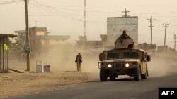 В городе Кундуз продолжаются бои между талибами и правительственными силами безопасности. 28 сентября 2015 года.