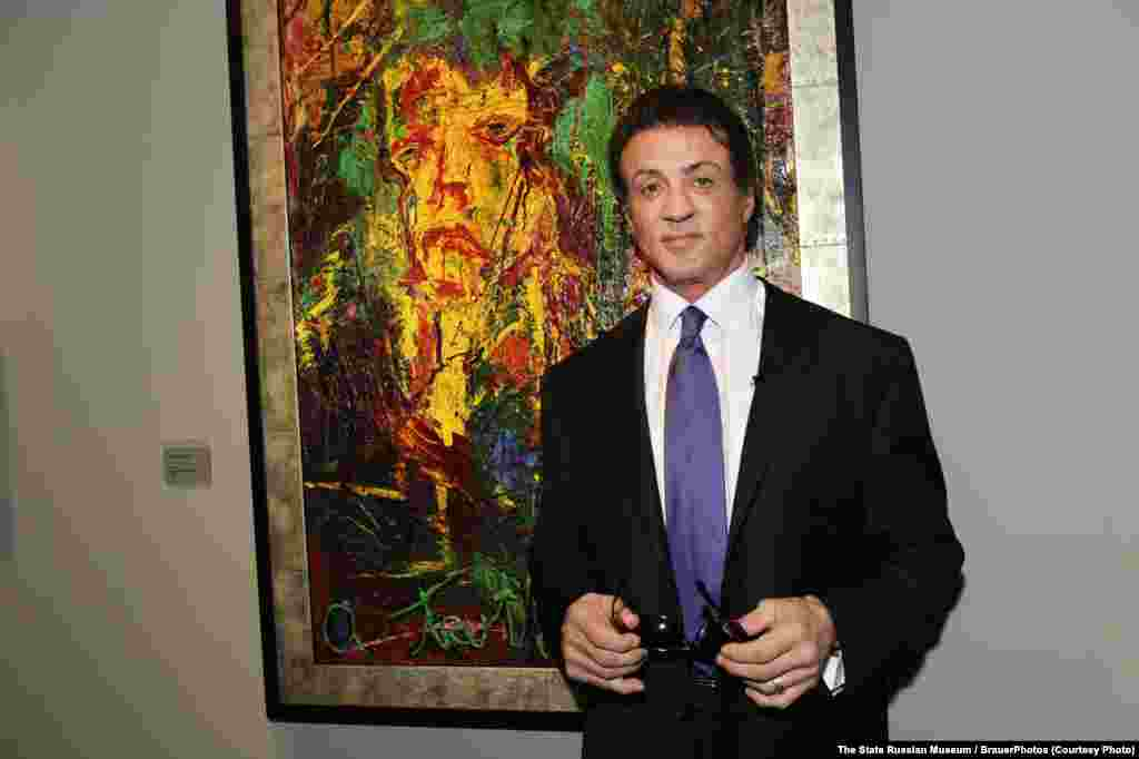 "Sylvester Stallone poses with his ""The Electric Burst of Creativity"" at the opening of Art Basel Miami Beach in Miami in 2009."
