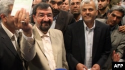 Presidential candidate Mohsen Rezai casts his ballot in June