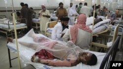 Burn victims injured in the tanker fire are treated at a hospital in Bahawalpur on June 25.