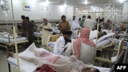 Pakistani burn victims are treated at a hospital in Bahawalpur after the fuel tanker explosion.