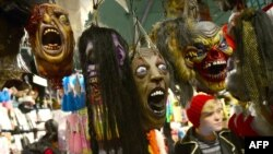 Morbid fixation? Halloween masks hang in a shop window in New York City on October 30.
