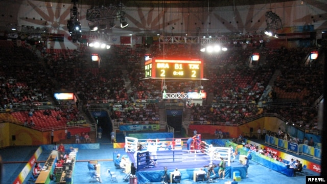 Bright lights, big money: a scene from the boxing competition at the Beijing Olympic Games in 2008.