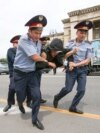 Kazakhstan - Police officers detain an opposition supporter during a protest against presidential election results, in Almaty, Kazakhstan, June 10, 2019. REUTERS/PavelMikheyev