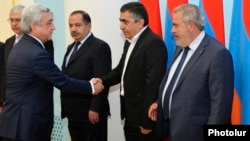 Armenia - President Serzh Sarkisian greets leaders of the Armenian Revolutionary Federation before concluding a new power-sharing agreement with them in Yerevan, 11May2017.