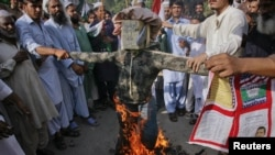 An effigy of U.S. President Barack Obama is burned during an anti-American demonstration in Hyderabad, Pakistan, in September.