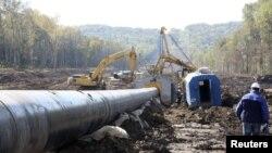 На строительстве новой ветки нефтепровода в Восточной Сибири.