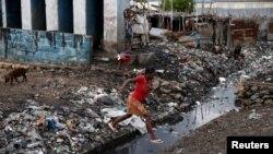 """Гаитидің Порт-о-Принс қаласындағы """"Мэтью"""" дауылынан кейінгі көрініс. 5 қазан 2016 жыл."""