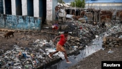 После урагана в городе Порт-о-Пренс в Гаити. 5 октября 2016 года.