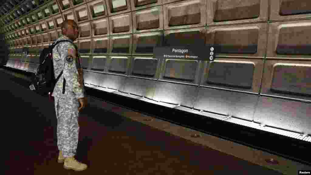 A U.S. soldier waits for his train during rush hour at the Pentagon Metro station in Washington. (Reuters/Kevin Lamarque)