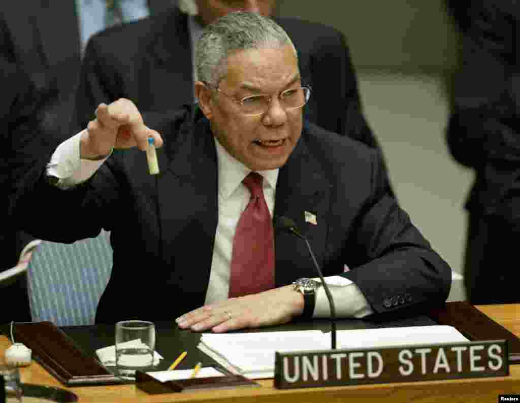 In the run-up to the invasion, the administration of U.S. President George W. Bush argued that Iraq was concealing weapons of mass destruction. Here, Secretary of State Colin Powell holds up a vial that he described as one that could contain anthrax during a presentation on Iraq to the UN Security Council on February 5, 2003.