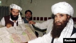 Jalaluddin Haqqani (right), whose militant network is aliied to the Taliban, may now be a target for U.S. raids.