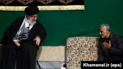Iranian Supreme Leader Ayatollah Ali Khamenei (L) greets the commander of Iran's Qods Force, Major General Qassem Soleimani, during a religious ceremony in Tehran, March 27, 2015