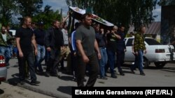 Mourners attend the funeral of Vladimir Grushin in June 2019 in Chemodanovka.