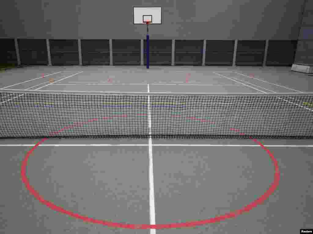 Tennis and basketball courts in the yard of the Detention Unit