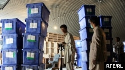 Election workers in Kabul load ballot boxes onto a truck in preparation for Afghanistan's presidential runoff election on November 7.